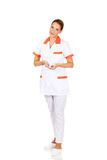 Young female doctor or nurse holding pink breast cancer awareness ribbon Royalty Free Stock Photos
