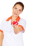 Young female doctor or nurse holding toy heart.  stock photography