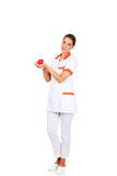 Young female doctor or nurse holding toy heart.  stock photo