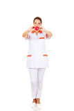 Young female doctor or nurse holding toy heart.  royalty free stock photography