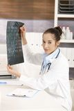 Young female doctor in office Royalty Free Stock Photography