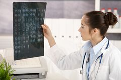 Young female doctor in office Stock Photos