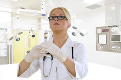 A young female doctor in the operating room Stock Image