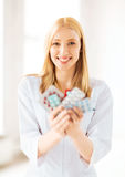 Young female doctor with pack of pills Royalty Free Stock Photo