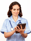 Young female doctor with PC tablet, isolated Royalty Free Stock Image