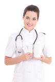 Young female doctor with pills over white Royalty Free Stock Photography