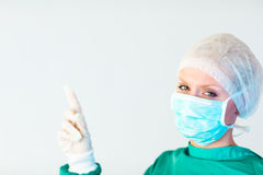 Young female doctor point finger upwards Stock Photos
