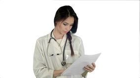 Young female doctor reading patient medical history forms on white background. Young female doctor reading patient medical history forms. Professional shot on stock video