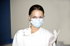 Young Female doctor ready for prostate examination Royalty Free Stock Images