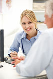 Young female doctor with senior patient Royalty Free Stock Image