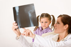 Young female doctor show x-ray to child Stock Images