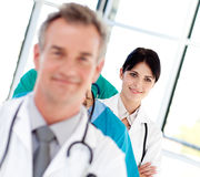 Young female doctor smiling at the camera Stock Image