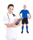 Young female doctor and soccer player in blue on white backgroun Stock Photography