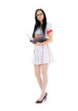 Young female doctor standing with clipboard over white Royalty Free Stock Images