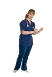 Young female doctor with stethoscope. And writing pad over white background Stock Image
