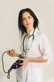 Young female doctor with a stethoscope. Close-up royalty free stock photos