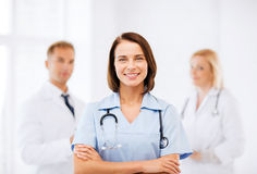 Young female doctor with stethoscope. Healthcare and medical concept - young female doctor with stethoscope Stock Photography