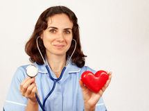 Young female doctor with stethoscope and heart, isolated stock images