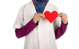 Young female doctor with stethoscope. Holding red human heart  life insurance and follow up program concept Stock Photography