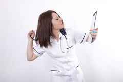 Young female doctor stressed Royalty Free Stock Photo