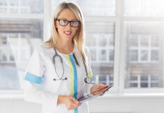 Young female doctor with tablet computer Stock Image