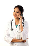 Young female doctor talking on mobile phone Royalty Free Stock Image
