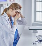 Young female doctor tired after working with computer royalty free stock image