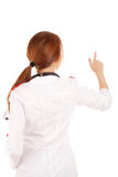 Young female doctor touchung virtual screen Royalty Free Stock Image