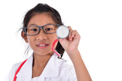 Young female doctor using stethoscope Stock Image