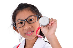 Young female doctor using stethoscope, Royalty Free Stock Image