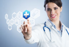 Young female doctor using touch screen interface. Stock Image