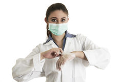 Young female doctor wearing gloves and mask Stock Photos