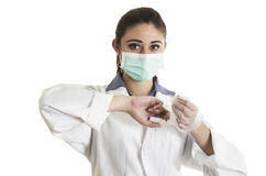 Young female doctor wearing gloves and mask Royalty Free Stock Image
