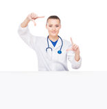 A young female doctor with a white banner Stock Images