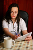 Young female doctor working Stock Photography