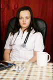 Young female doctor working Royalty Free Stock Image