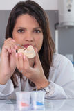 Young female doctor working on dental prosthesis laboratory Stock Images