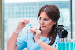 The young female doctor working in the lab Stock Image