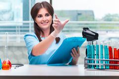 The young female doctor working in the lab Royalty Free Stock Image