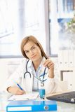 Young female doctor working in office Royalty Free Stock Photos