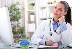 Young female doctor working in office Royalty Free Stock Image