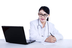 Young female doctor is writing prescription Stock Photos