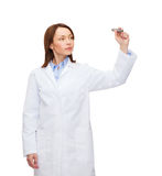 Young female doctor writing something in the air Royalty Free Stock Image