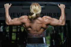 Young Female Doing Back Exercises In The Gym Stock Photo