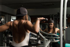 Young Female Doing Back Exercises In The Gym Royalty Free Stock Image