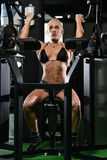Young Female Doing Biceps Exercises In The Gym Stock Photo