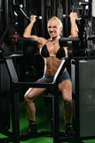 Young Female Doing Biceps Exercises In The Gym Royalty Free Stock Images