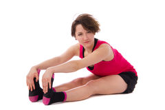 Young female doing exercise. On white background Stock Photo