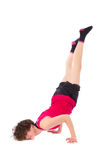 Young female doing exercise. On white background Stock Photography