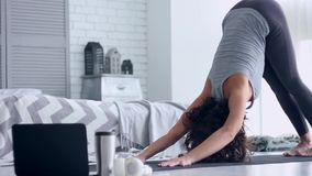 Young woman doing yoga workout at home stock footage